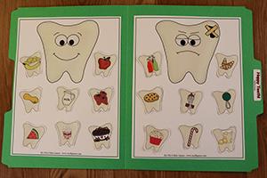 Happy Teeth Folder Game